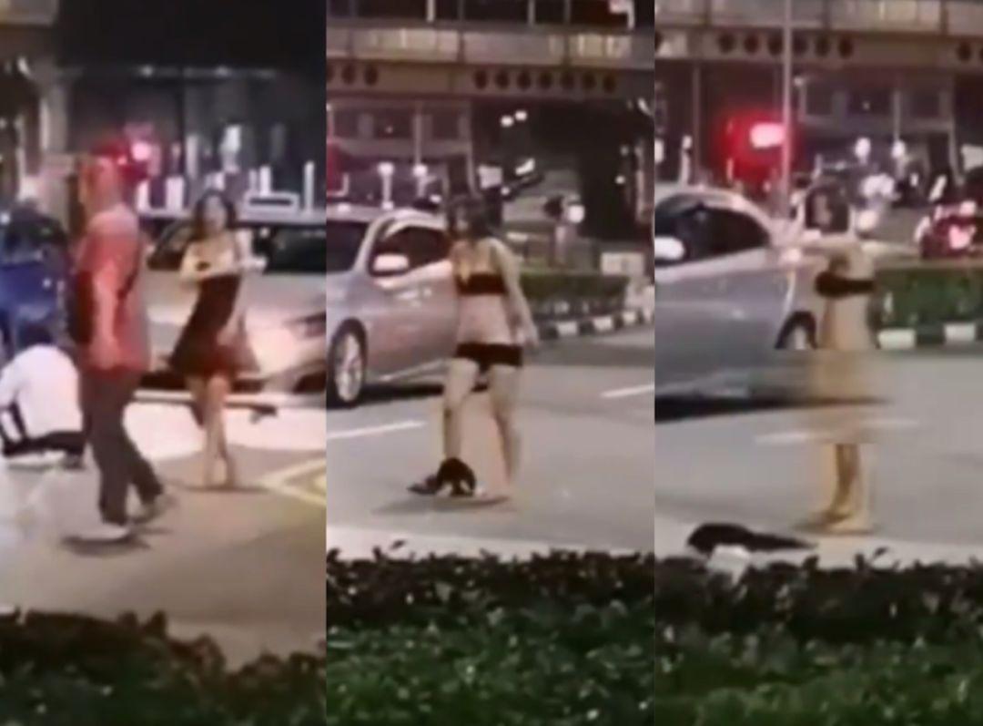 与德士司机起冲突,女子新加坡街头扒衣,近乎全裸!